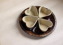 Four ceramic bowls and round ceramic plate Royalty Free Stock Images