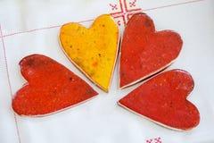 Four ceramic hearts Stock Photos