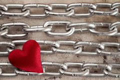 Four chains with red heart Royalty Free Stock Image