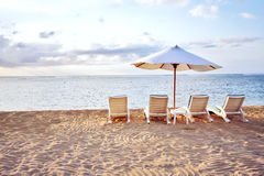 Four Chair at the Beach. Four Chair and White Umbrella at the Beach Stock Image
