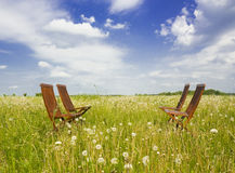 Four chairs. In the grassland Royalty Free Stock Photos