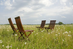 Four chairs. In the grassland Stock Photos