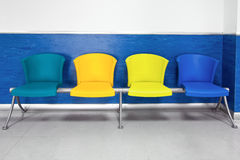 Four chairs color. Colorful chairs in the waiting room of the hospital Stock Photo