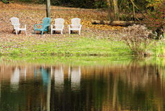 Four chairs by the lake Stock Images