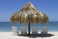 Four Chairs and Palapa Stock Photo