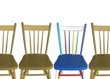 Four Chairs, three brown, one colorful Royalty Free Stock Photography