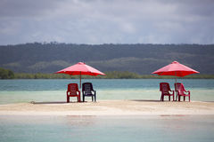 Four chairs and umbrella on tropical beach, venezuela Stock Images