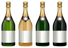 Four champagne bottles with golden lid Royalty Free Stock Photos
