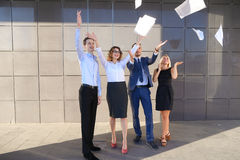 Four charming young people, two women and two men students, entr Royalty Free Stock Photography