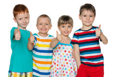 Four cheerful children hold his thumbs up Royalty Free Stock Image