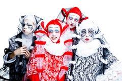 Four cheerful clown Stock Photos