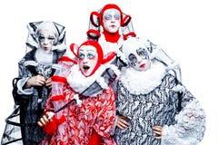 Four cheerful clown Royalty Free Stock Photos
