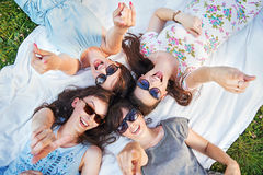 Four cheerful ladies in a pointing pose Stock Image
