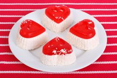 Four cheese cake in the form of heart on a white plate Stock Photography