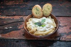 Free Four Cheese Pasta With Garlic Bread On Rustic Wooden Background Royalty Free Stock Photos - 160657078