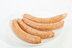 Four Cheesy Russian Sausages on White Plate Stock Image