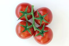 Four cherry tomatoes royalty free stock photography