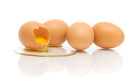 Four chicken eggs on white background Stock Photo