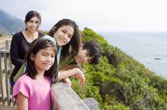 Four children along the ocean shore Royalty Free Stock Image