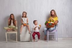 Four children with fresh vegetables healthy food royalty free stock images