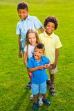 Four children on the glade. Royalty Free Stock Photos