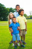 Four children on the glade. Royalty Free Stock Image