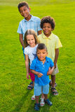 Four children on the glade. Stock Photo