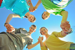 Four children holding hands royalty free stock image