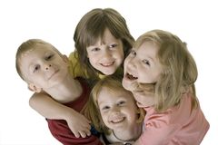 Four children hugging from above Royalty Free Stock Photos