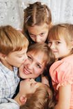 Four children kissing mother. Family concept Stock Photos