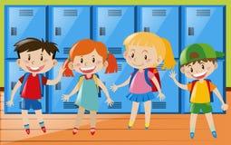 Four children in locker room Royalty Free Stock Image