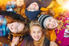 Children outdoor on autumn leaves royalty free stock photo