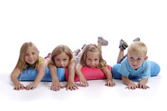 Four children lying on the floor Royalty Free Stock Photography