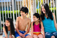 Four children by the pool side Stock Image