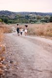 Four children running outdoor Stock Image