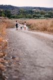 Four children running outdoor Royalty Free Stock Image