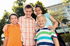 Four children. Four smiling children looking at the camera Royalty Free Stock Photo