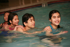 Free Four Children Swimming Together Stock Images - 9634514