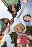 Four Children Wearing Costumes Outdoors Stock Photo