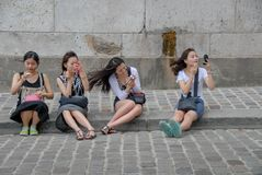 Four chinese females applying make-up royalty free stock photography