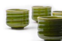 Four chinese tea cups. Green ceramic,hand made tea cups for Chinese green tea. Shot on a white background Royalty Free Stock Photography
