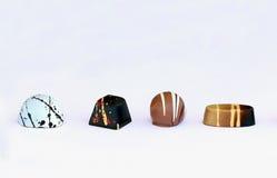 Four chocolate bonbons on white background Stock Photo