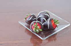 Four chocolate covered strawberries Royalty Free Stock Photos