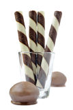 Four chocolate wafer sticks. Royalty Free Stock Photos