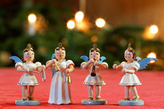 Four Christmas Angels Making Music. Four decoration angels making music in front of Bokeh Christmassy lights stock photo