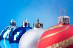 Four christmas balls Royalty Free Stock Photos