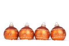 Four christmas balls. Four christmas orange gold balls and snow Royalty Free Stock Photos