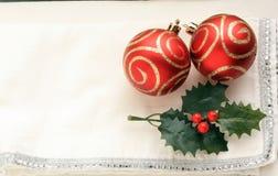 Four Christmas balls hang white background Stock Image