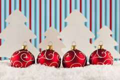 Four Christmas baubles on abstract background Royalty Free Stock Photos