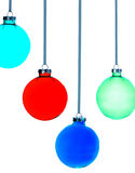 Four Christmas baubles on white background Royalty Free Stock Photography